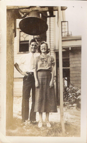 Kitty and Charles Wills under the Engagement Bell at Wheaton College.