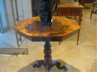 This beautiful wood-inlay table in a shop window