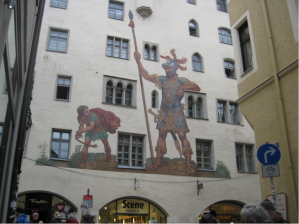 Notice Goliath's left arm around the window frame