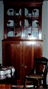 A cherry-wood china cabine