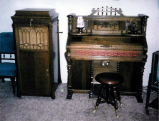 An old pump organ and an antique wind-up record player