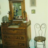 The dresser in Granny's room, with an ice-cream chair
