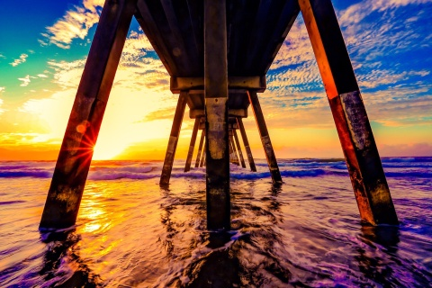 under-a-pier-at-sunrise